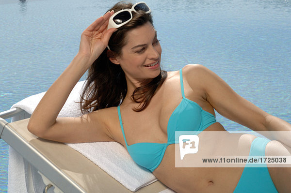 Woman on the sunlounger with sunglasses