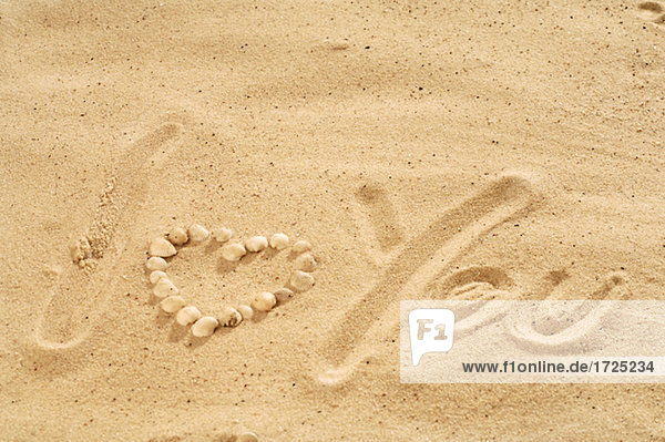 I love you' written in the sand