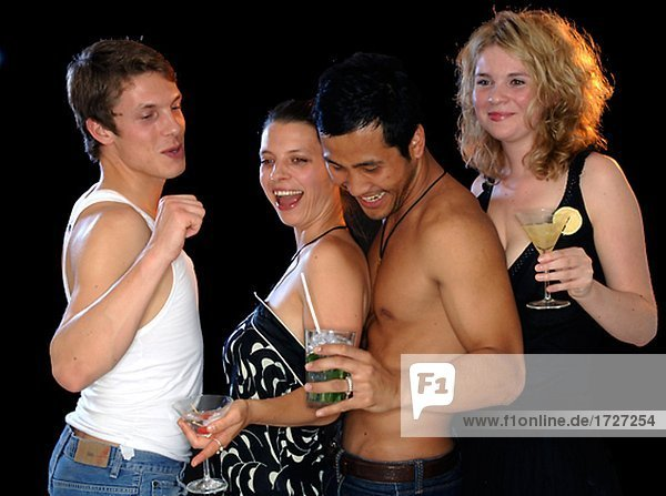 Group of young people drinking cocktails