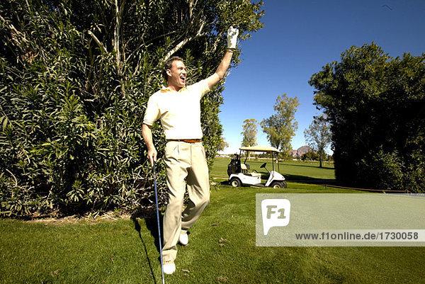Jubel männlichen Golfspieler