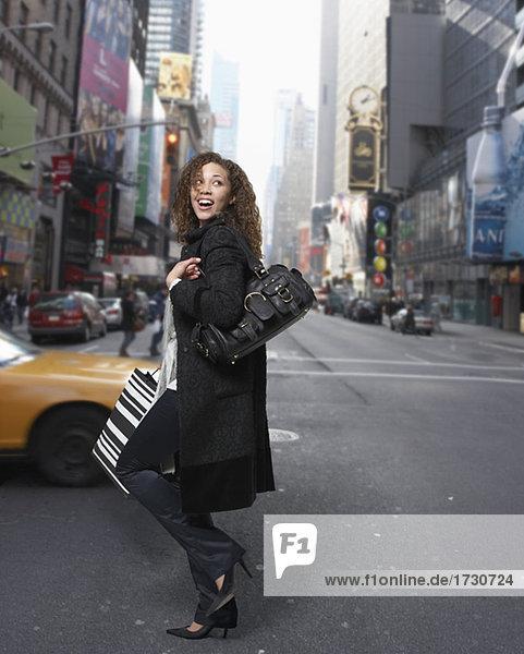 Woman crossing urban street