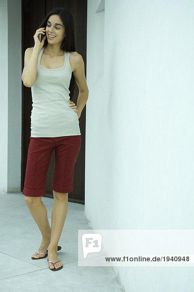 Woman standing using phone  full length portrait