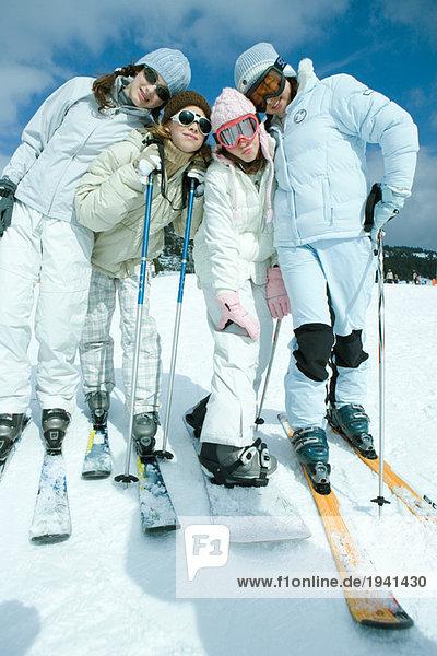 Group of teen girls in ski gear  full length portrait