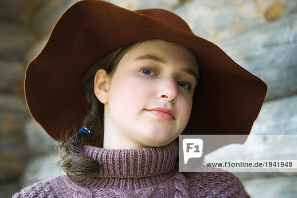 Teenage girl wearing turtleneck and hat  portrait