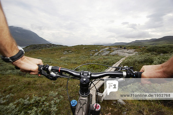 Sweden  Lapland  person riding bicycle