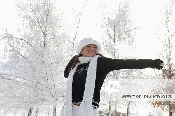 Young woman in snow  stretching