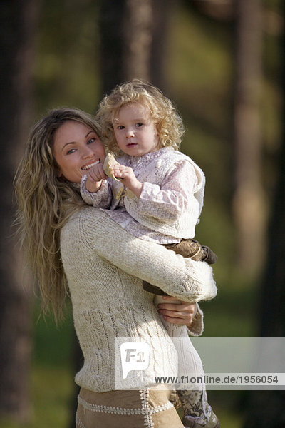 Mother carrying daughter  portrait