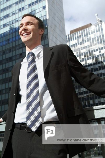 Happy business man in urban environment