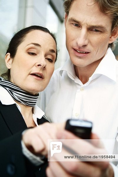 Colleagues looking at mobile