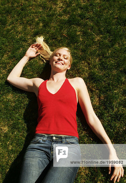 Young woman resting in the grass