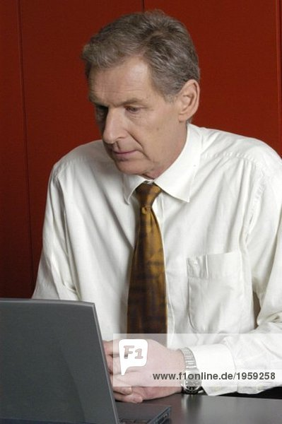 Businessman looking at a monitor