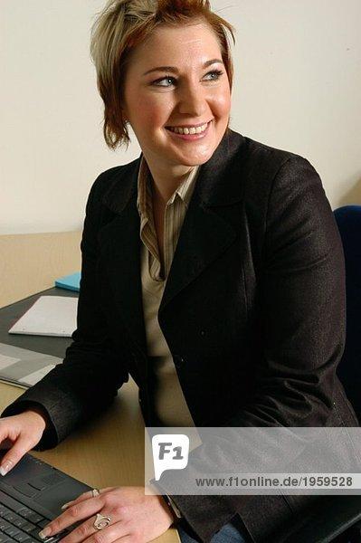 Woman turning around at desk