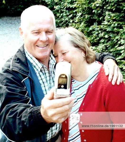Elderly couple with camera phone