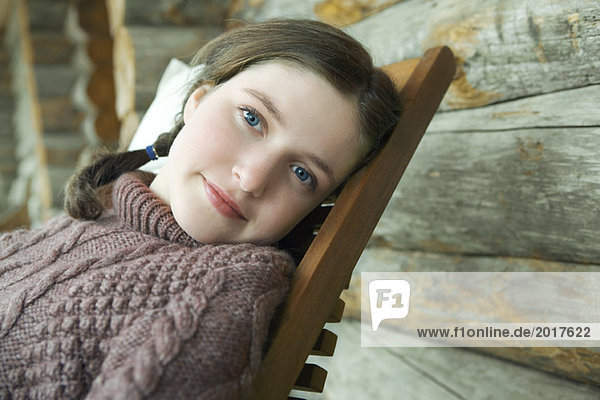 Teen girl leaning back in chair  portrait