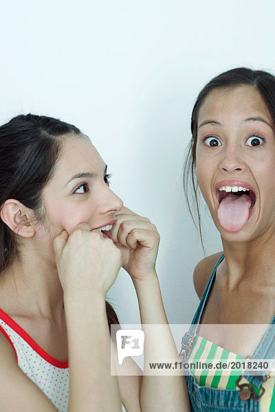 Two young female friends making faces  portrait