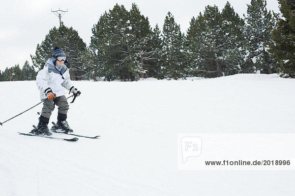 Boy skiing  full length
