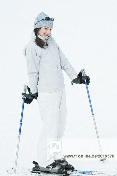 Teen girl wearing skis  smiling