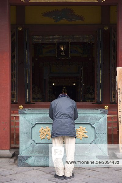 A man praying at a temple