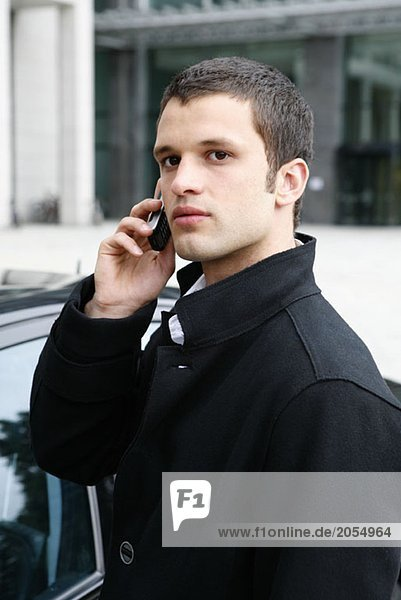 A young man using a mobile phone