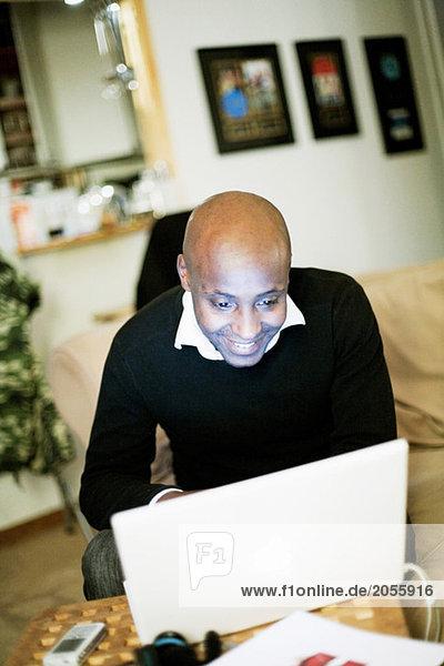 Man behind white computer