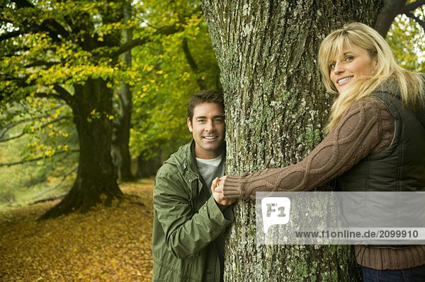 Germany  Baden-Württemberg  Swabian mountains  Couple smiling and hugging tree  portrait