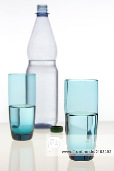 Close-up of glasses and bottle of water