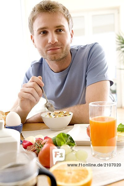 men eating breakfast cereals