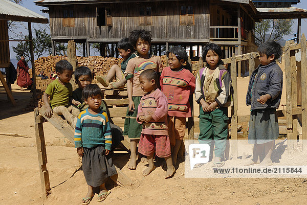 Group of children in front of hut  Kalaw  Shan State  Myanmar
