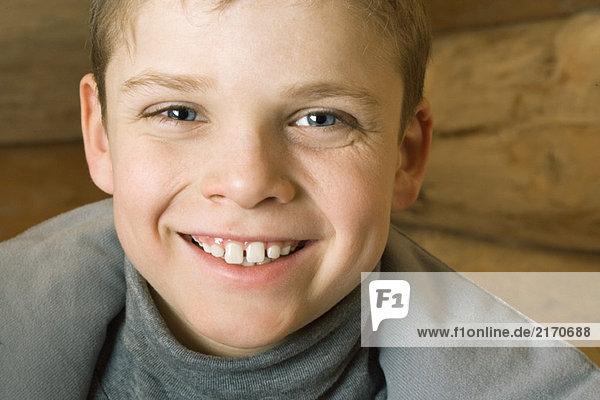 Boy smiling at camera  portrait