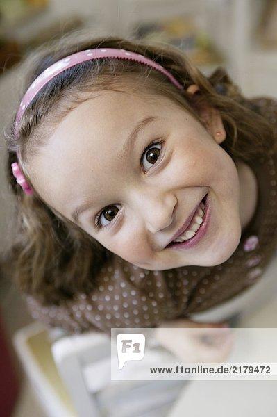 Girl smiling at camera