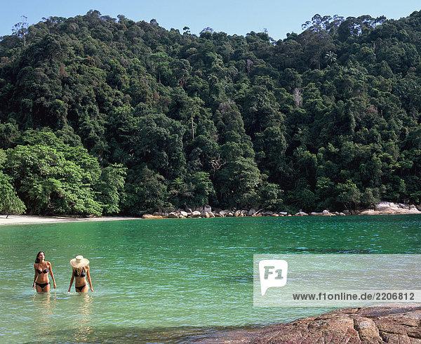 Malaysia  Pangkor Laut  women at sea in shallow water