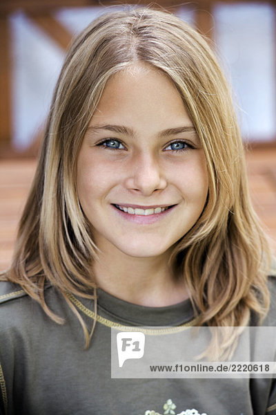 Portrait of a girl (13-14)  smiling