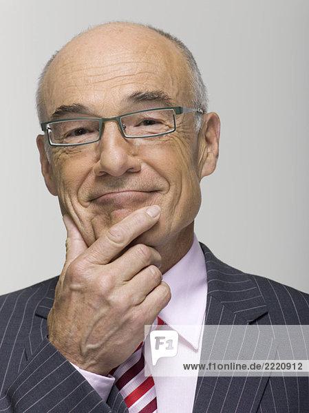Portrait of a senior businessman  hand on chin