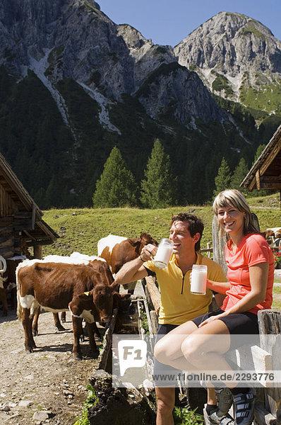 Austria  Salzburger Land  Couple drinking milk