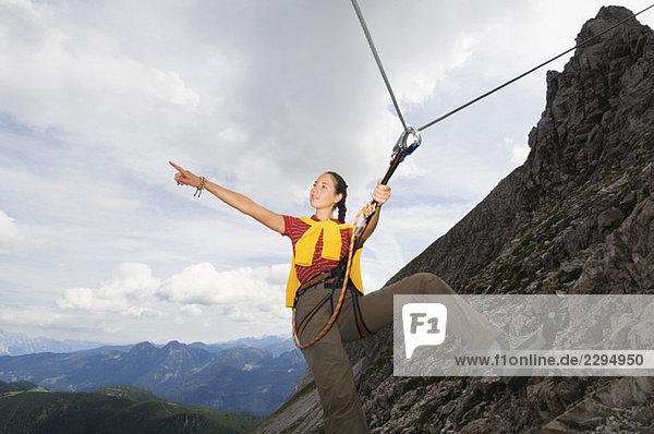 Austria  Salzburger Land  young woman mountain climbing