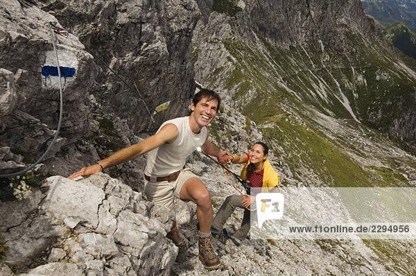 Austria,  Salzburger Land,  couple mountain climbing
