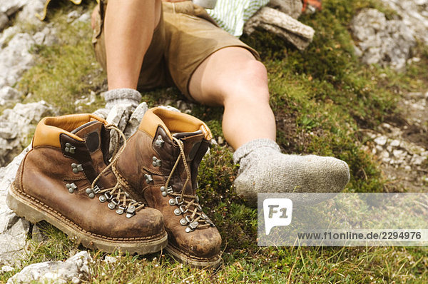 Austria  Salzburger Land  hiking boots and laying man