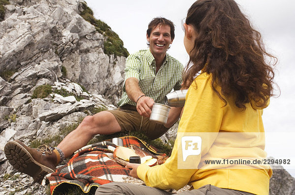 Austria  Salzburger Land  couple having picnic