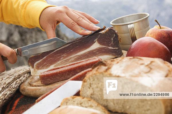 Austria  Salzburger Land  picnic with bread and ham