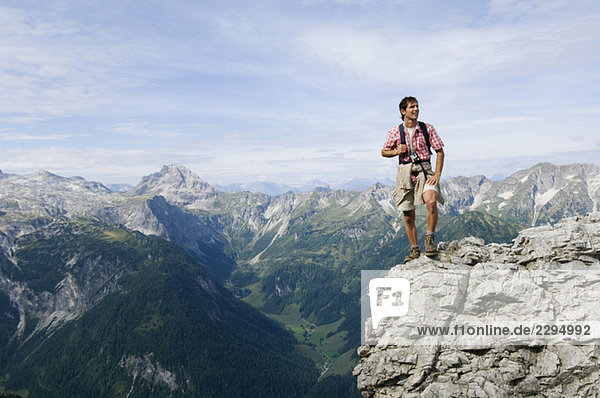 Austria  Salzburger Land  young man on mountain top