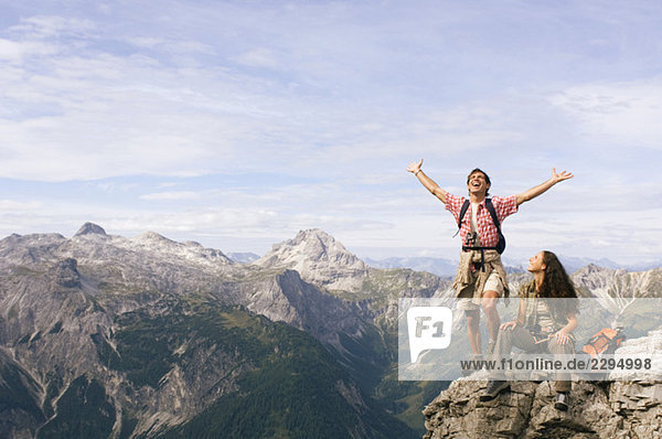 Austria  Salzburger Land  young couple cheering