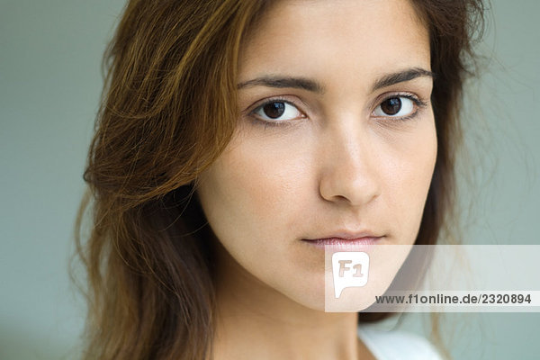 Young woman  looking at camera  close-up  portrait