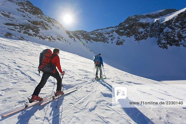 Two skiers skiing  Ennstal  Obersteiermark  Obertal  Vetternspitze  Sauberg  Austria