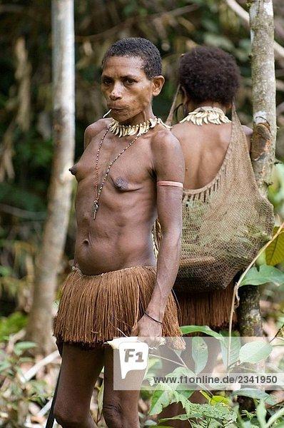 Papuan tribeswomen in jungle  Indonesia