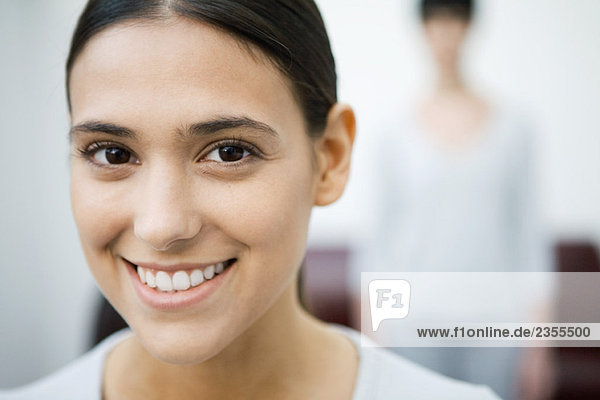 Woman smiling at camera  portrait
