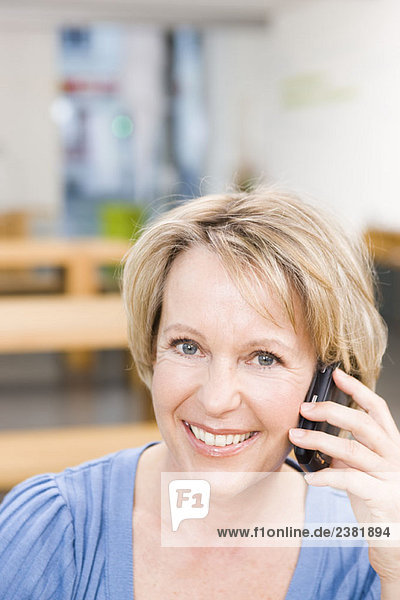 Portrait of a blond woman phoning