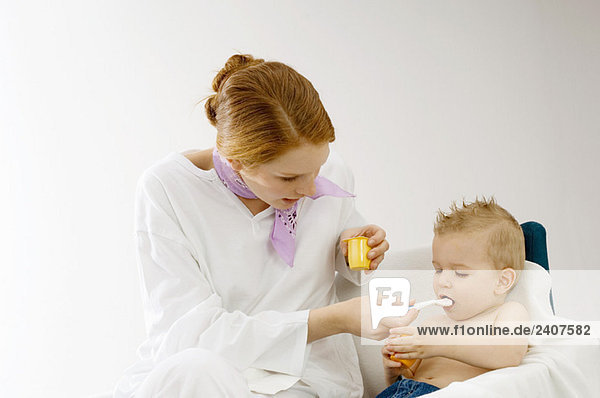 Young woman feeding to her son