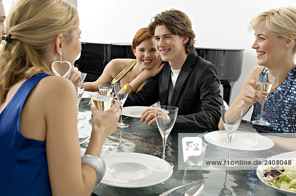 Teenage boy with his friends at a dinner party