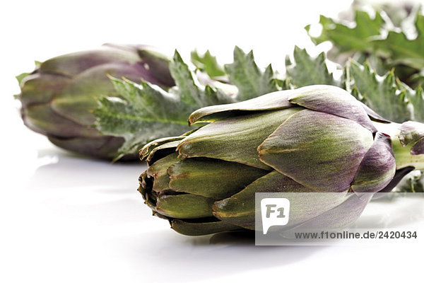 Artichokes with leaves  close-up