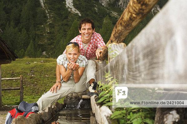 Austria  Salzburger Land  couple drinking water